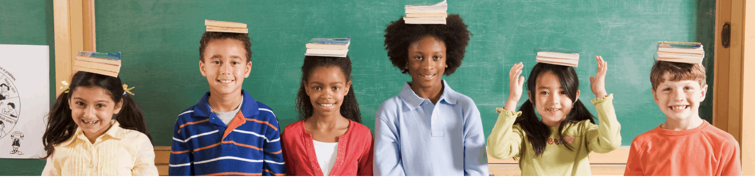 Students with Books on Heads